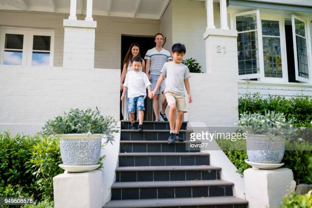 young mixed family leaves the house. - in front of stock pictures, royalty-free photos & images