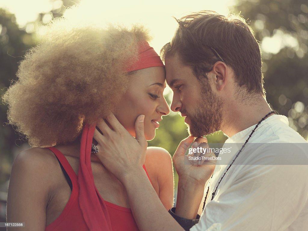 Young mixed race couple enjoying together : Stock Photo