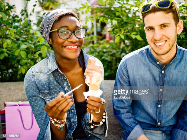 Young mixed race couple with ice cream