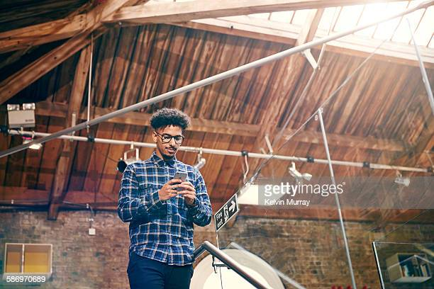A young mixed race creative professional on phone