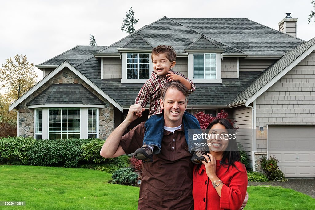 Young Mixed Race Family of Three at Home : Stock Photo