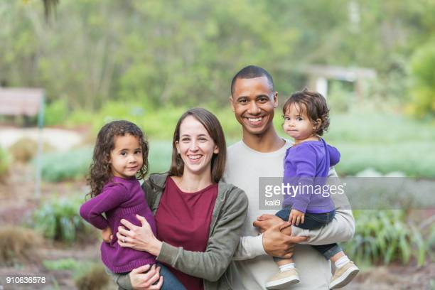 Young mixed race family with two little girls