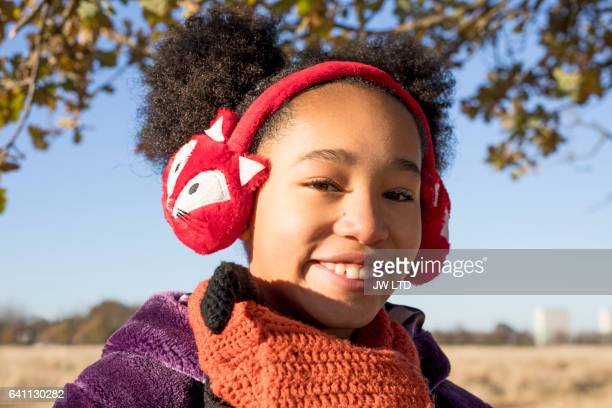 Young mixed race girl laughing in autumn landscape 10-11
