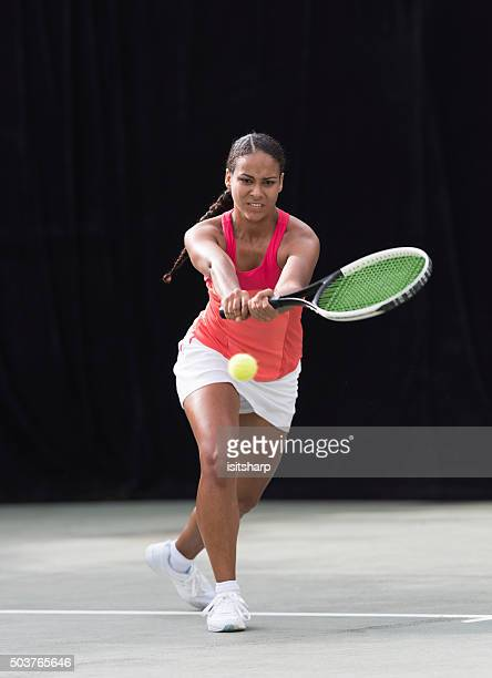young mixed race girl playing tennis - racquet sport stock photos and pictures
