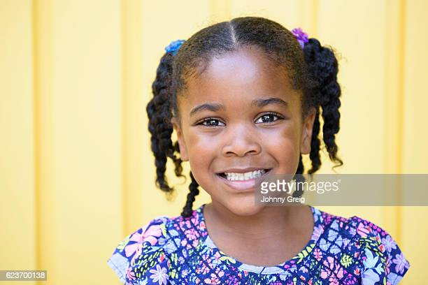 Young mixed race girl smiling towards camera, portrait