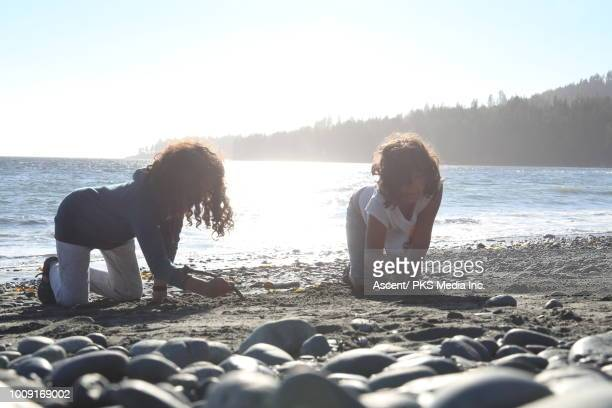 young mixed race girls enjoy beach freedom - vancouver island stockfoto's en -beelden