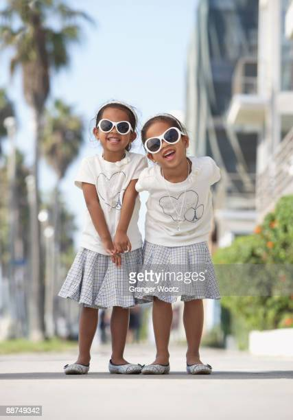 Young mixed race girls wearing sunglasses
