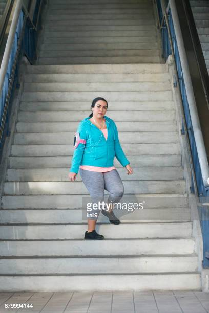 Young mixed race Hispanic woman on staircase