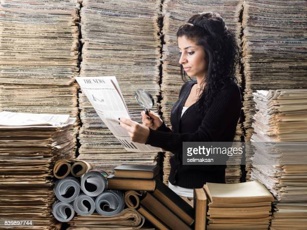 Young Mixed Race Woman Doing Research In Media Library