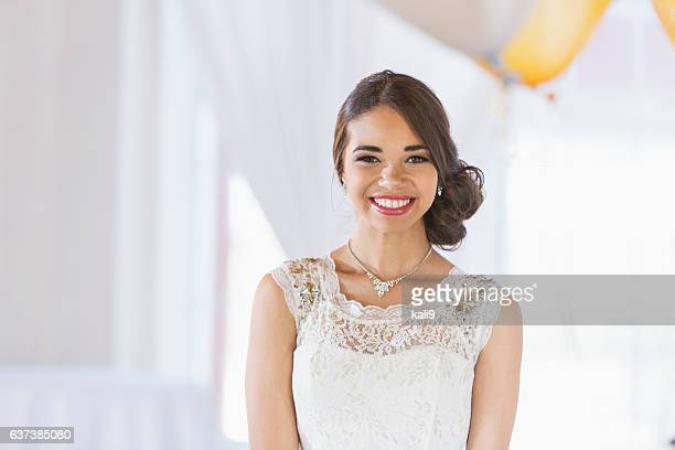 Young mixed race woman in white dress