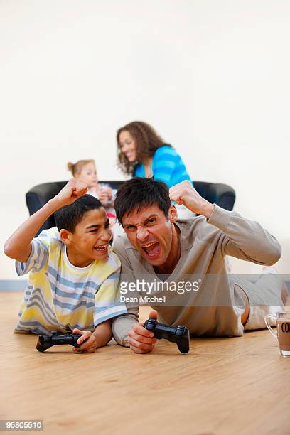 young mixedrace Family playing video games at home