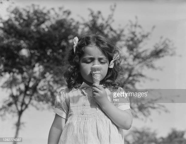 Young model Nina Filardi eating an ice cream in Thornwood New York State May 1939