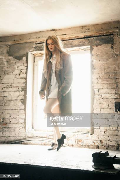 Young model posing in abandoned building