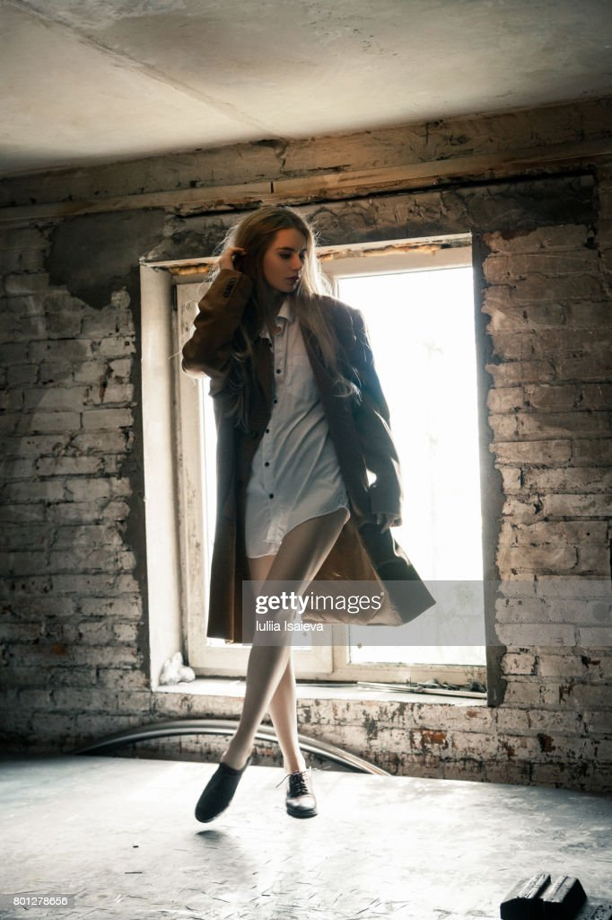 Young Model Posing In Abandoned Building High Res Stock Photo Getty Images