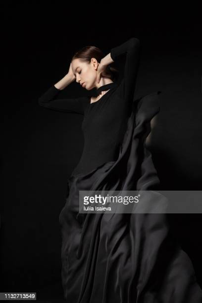 young model touching head and dancing - vogue stock pictures, royalty-free photos & images