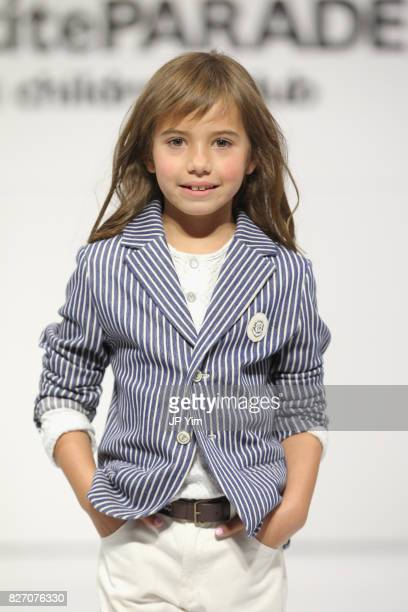 A young model walks the runway for Choupette collection during petitePARADE at Children's Club at Jacob Javitz Center on August 6 2017 in New York...