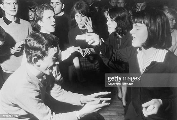 Young mods dancing during a recording of the British pop music TV programme 'Ready Steady Go' London February 1964