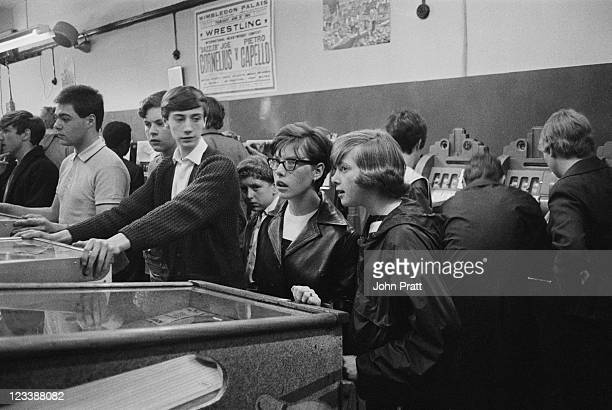 Young Mods in an amusement arcade in London 1964