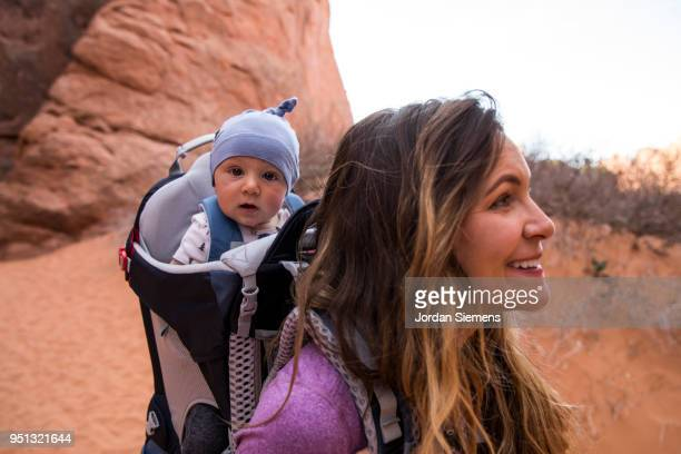 A young mom hiking with her baby