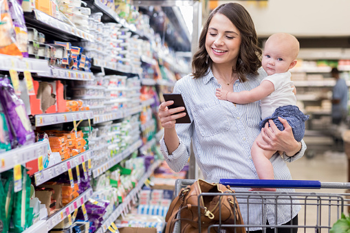 Young mom shops with her baby in supermarket - gettyimageskorea