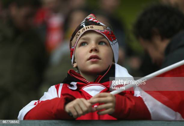 A young Monaco fan looks on prior to the UEFA Champions League Quarter Final first leg match between Borussia Dortmund and AS Monaco at Signal Iduna...