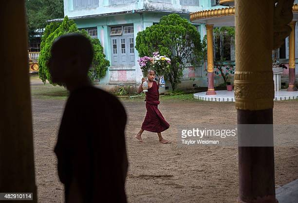 A young monk carries flowers to a shrine in a monastery near the planned Dawei SEZ on August 3 2015 in Pantininn Myanmar The controversial...