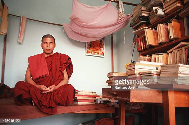 A young monk in his dormitory at a temple school in Mandalay