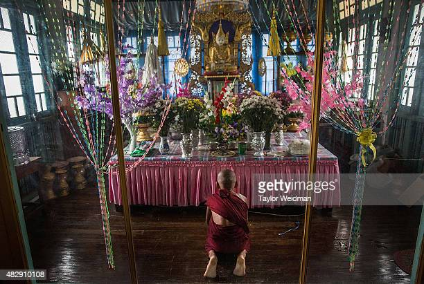 A young monk prays in front of an altar in a monastery near the planned Dawei SEZ on August 3 2015 in Pantininn Myanmar The controversial...