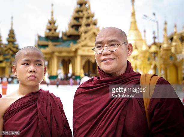 Young monk with his abbot in the Shwedagon Pagoda in Yangon on June 16 2016 in Yangon Myanmar