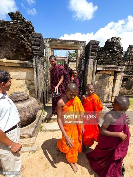 young monks at  hetadage ruins of polonnaruwa, sri lanka - national landmark stock pictures, royalty-free photos & images