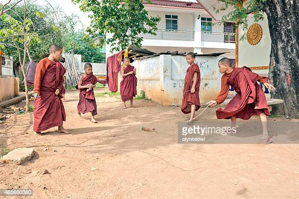 Young Monks Indulging In A Game Of Spinning Tops