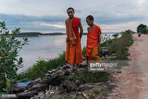 Young monks near a monastery along the Mekong River in Vientiane Laos in September 2016