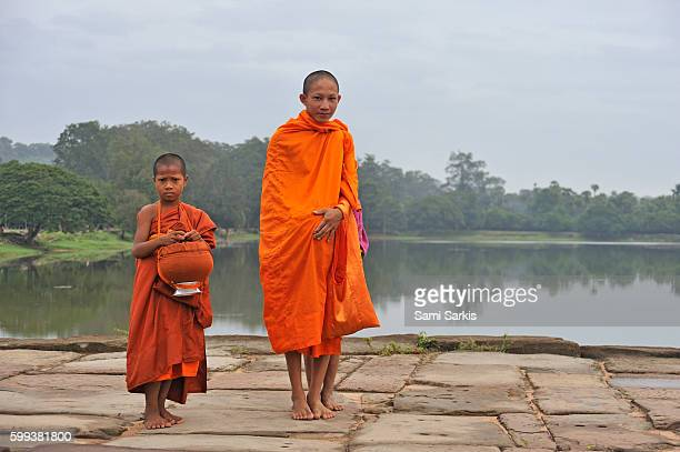 Young monks on their way to Angkor Wat, Siem Reap, Cambodia, Southeast Asia
