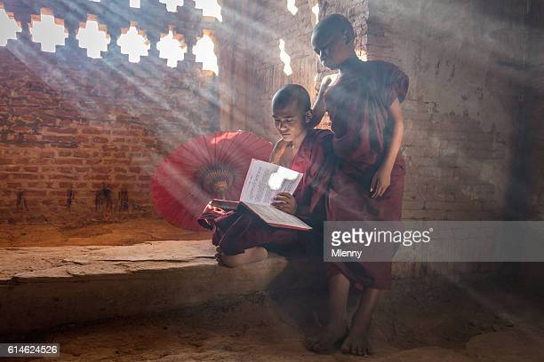 Young Monks reading Buddhist Book inside Temple Bagan Myanmar