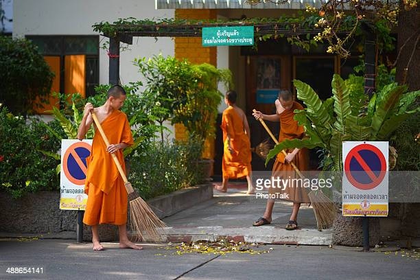 Young Monks Sweep The Floor