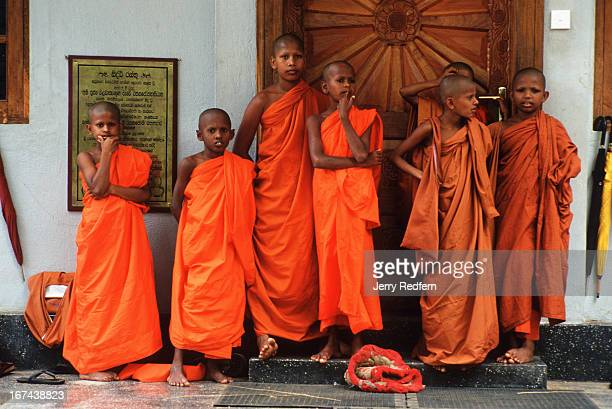 Young monks wait for classes to start at a school at the base of Mihantale mountain near Anuradhapura