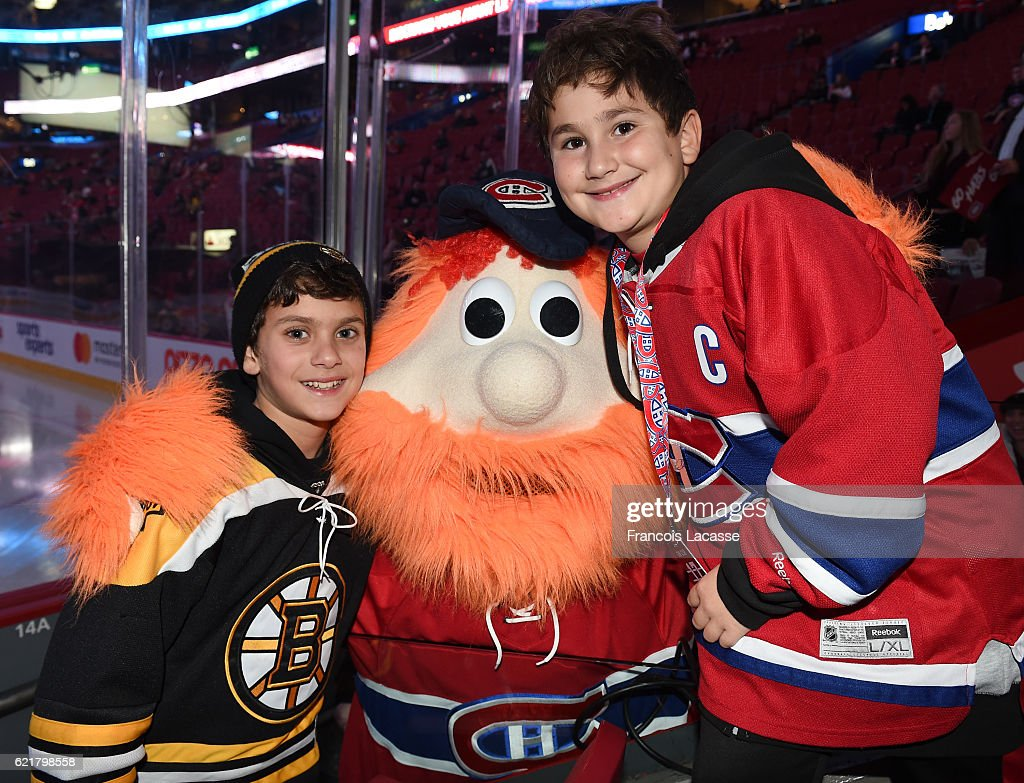 Young Montreal Canadiens and Boston Bruins fans pose with Youppi prior the NHL game at the Bell Centre on November 8, 2016 in Montreal, Quebec, Canada.