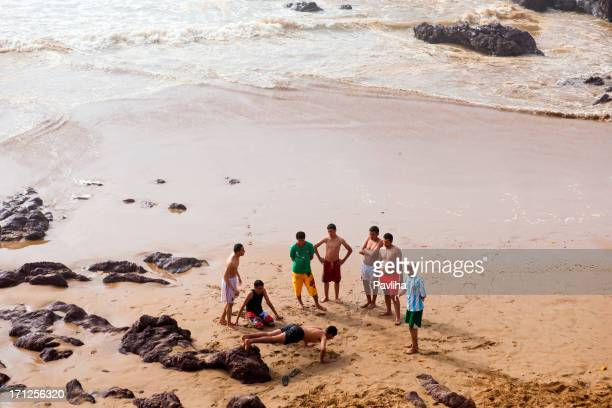 young moroccan doing push-ups on atlantic coast - pavliha stock photos and pictures