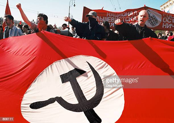 A young Moscovite a member of the National Bolshevik Party raises his fist as he marches with proCommunist demonstrators May 1 2001 in downtown...