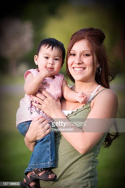 young mother and baby - mexican mothers day stock photos and pictures