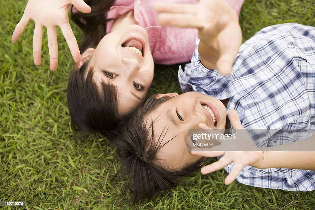 young mother and child having fun in the park : Stock Photo