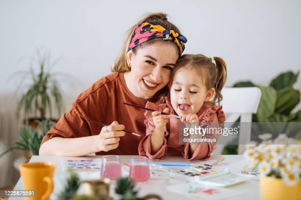young mother and daughter having fun time at home - family with one child stock pictures, royalty-free photos & images