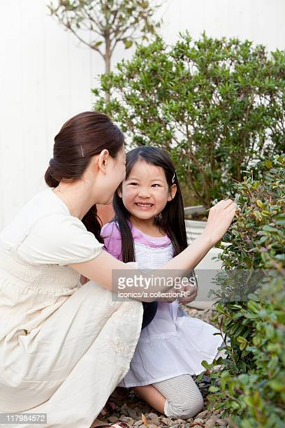 Young Mother and Daughter in Garden
