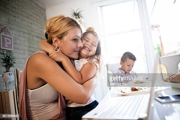 Young  mother and her little girl using computer.