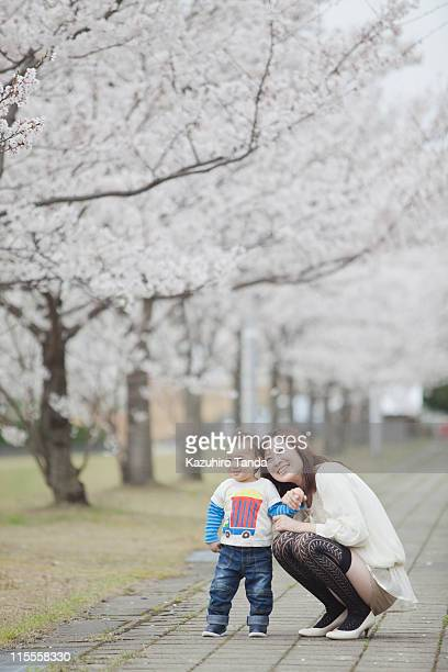 young mother and her son looking up