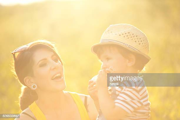 Young Mother and her Son on a Summer Meadow
