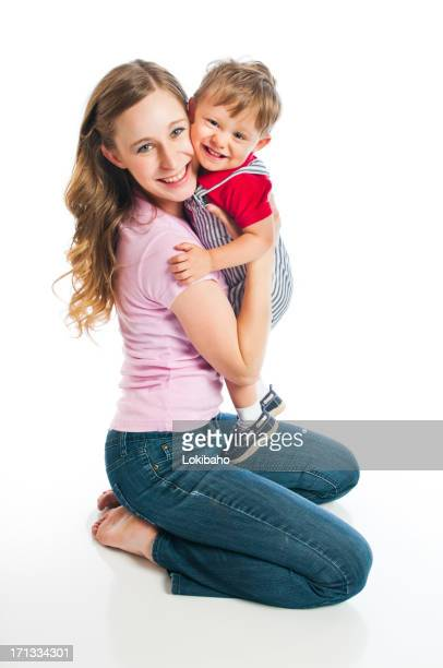 Young Mother and holding toddler boy