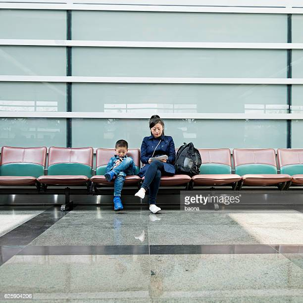 Young mother and son at airport