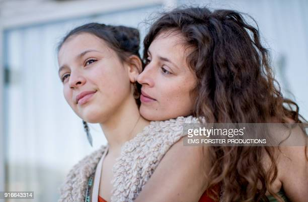 young mother are very close together with her teenager child - zus stockfoto's en -beelden