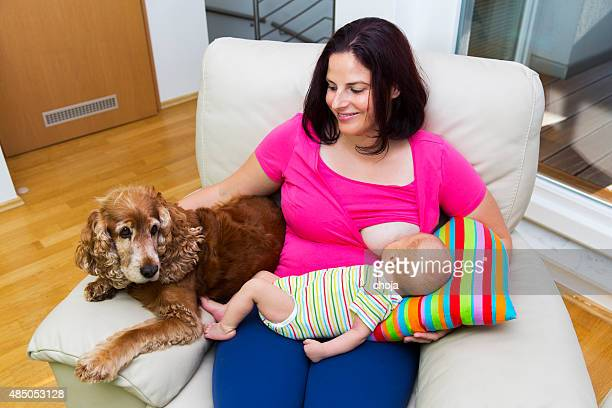 Young mother breastfeeding her little newborn boy